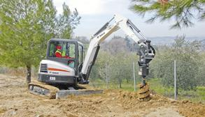 Bobcat E35 compact (mini) excavator with auger attachment.