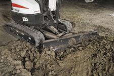 Bobcat compact (mini excavator) with angle blade.