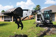 Bobcat E35i compact (mini) excavator with clamp attachment.