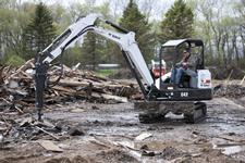 Bobcat E42 compact (mini) excavator with a breaker attachment.