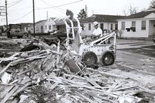 M500 cleaning up in New Orleans after Hurricane Betsy, 1965, Sid Duhon operating.