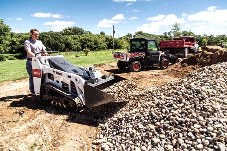Bobcat MT55 mini track loader scoops rock.