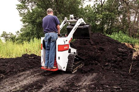 Ride-on platform on Bobcat MT85 mini track loader.