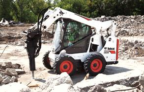 Skid-steer loader with planer attachment