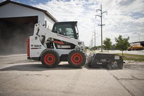 Bobcat sweeper Attachment on the S570 Skid-Steer Loader