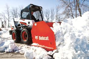 Bobcat S630 skid-steer loader pushes snow pile