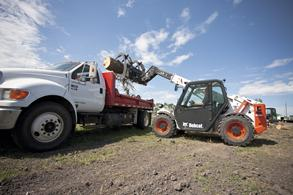Bobcat compact track loader, compact excavator, and Toolcat utility work marchine working together.