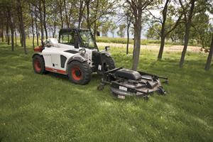 Bobcat V417 VersaHANDLER (telehandler) telescopic tool carrier uses a front-mounted mower attachment.