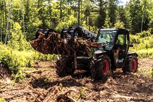 VersaHANDLER V519 telehandler and its grapple attachment loaded with roots