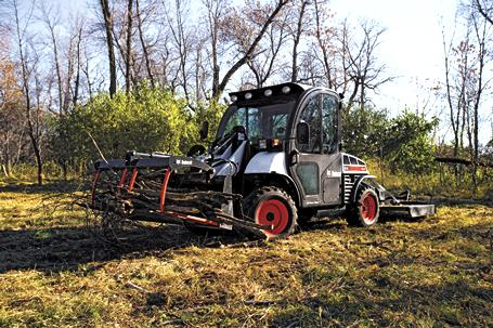 5610 Toolcat utility work machine with grapple utility fork attachment.