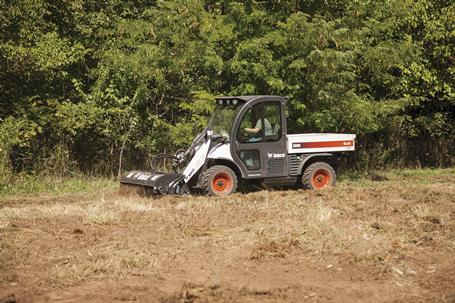 A Toolcat 5600 travels at a consistent speed while using a tiller attachment.
