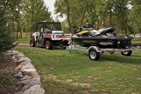 Bobcat 3600 utility vehicle tows a jet ski on a trailer.
