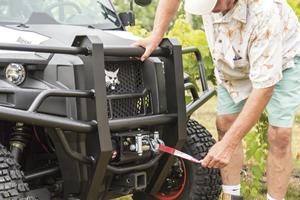 Winch accessory on Bobcat 3400 utility vehicle.