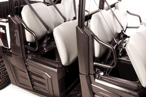 Seats opened on Bobcat 3400XL utility vehicle to show storage compartments.
