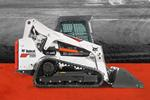 Bobcat T650 compact track loader and bucket attachment.