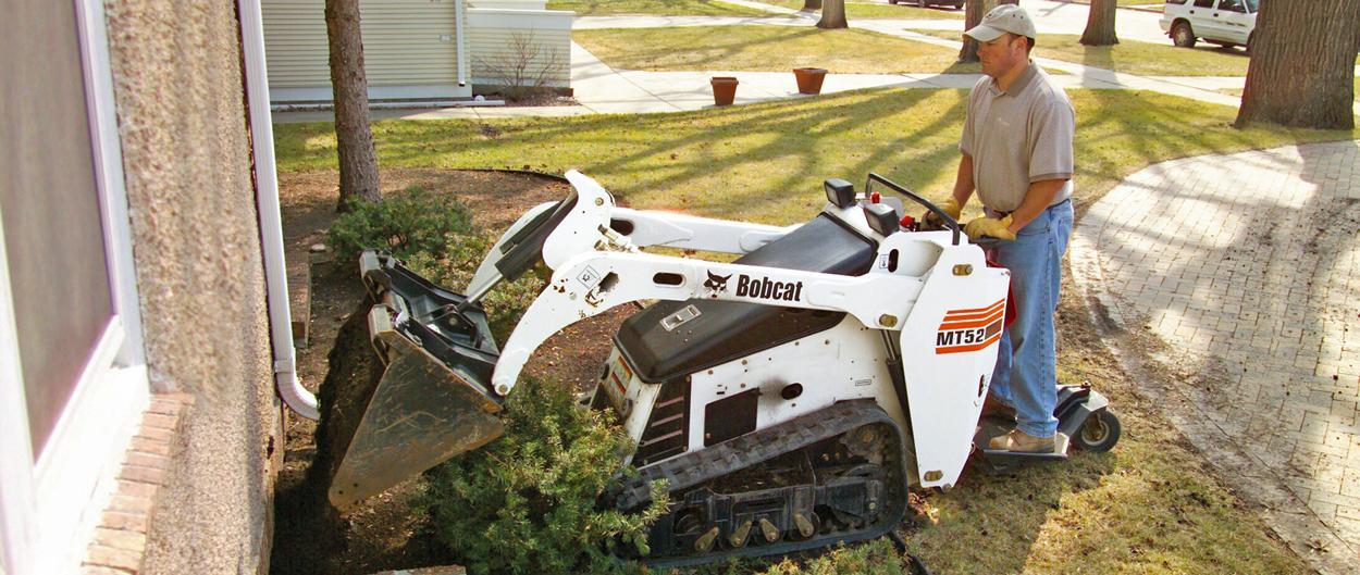 Bobcat MT52 mini track loader with bucket.