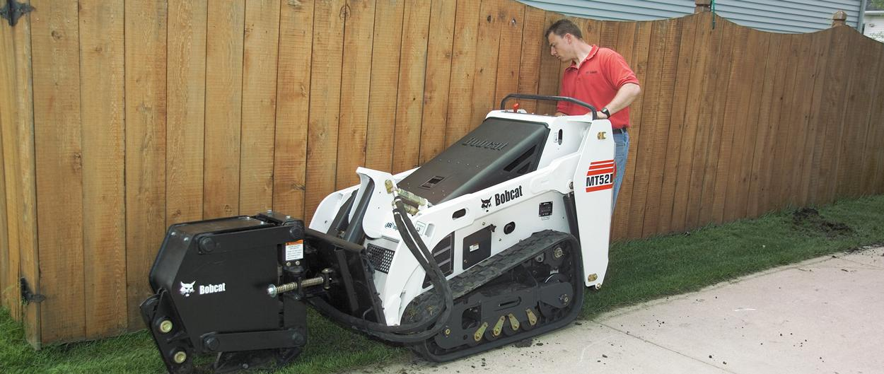 Bobcat MT52 mini track loader with vibratory plow attachment.