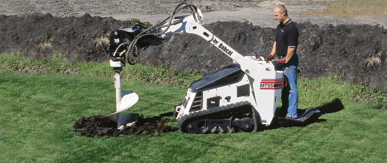 Bobcat MT55 mini track loader with auger attachment.