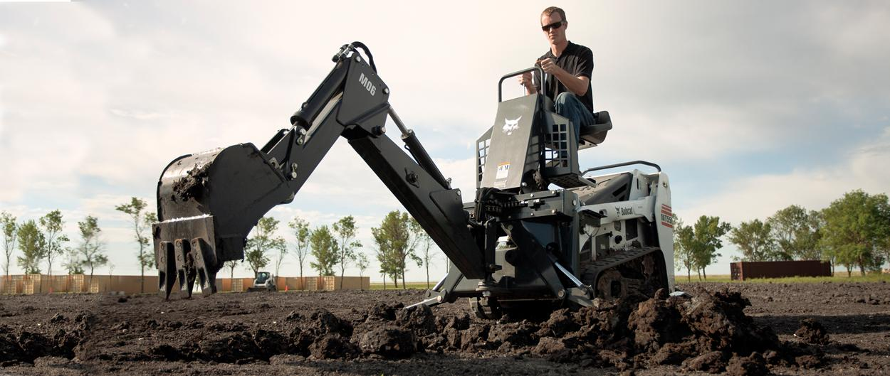 Bobcat mini track loader with backhoe attachment.