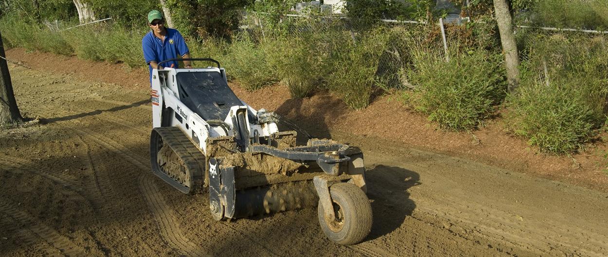 Bobcat MT55 mini track loader with soil conditioner attachment.