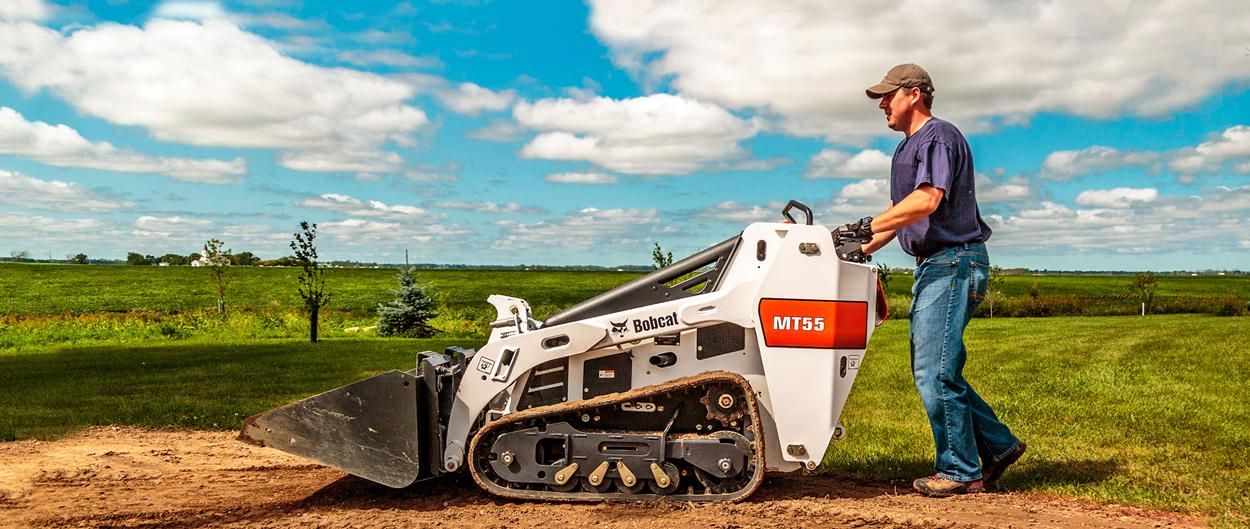 Bobcat MT55 mini track loader with bucket attachment.