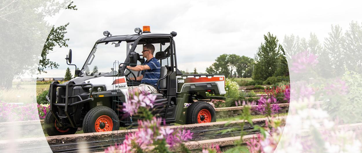 Bobcat 3400 utility vehicle (UTV) is driven through a winery.