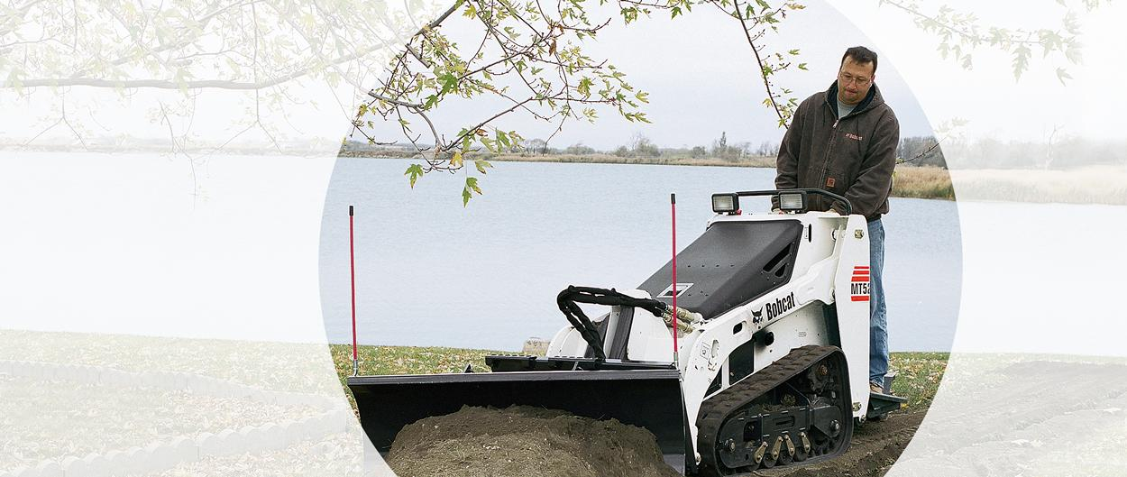 Bobcat MT52 mini track loader with utility blade attachment.