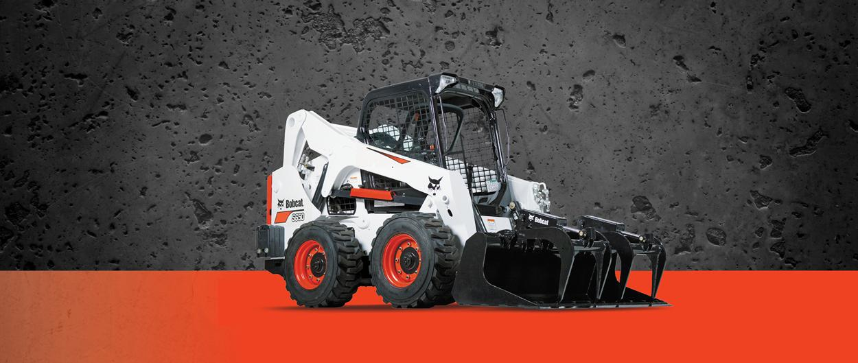 Bobcat S650 skid-steer loader and grapple attachment.