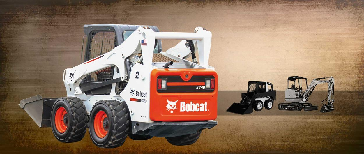 Bobcat S740 skid-steer loader with bucket attachment.