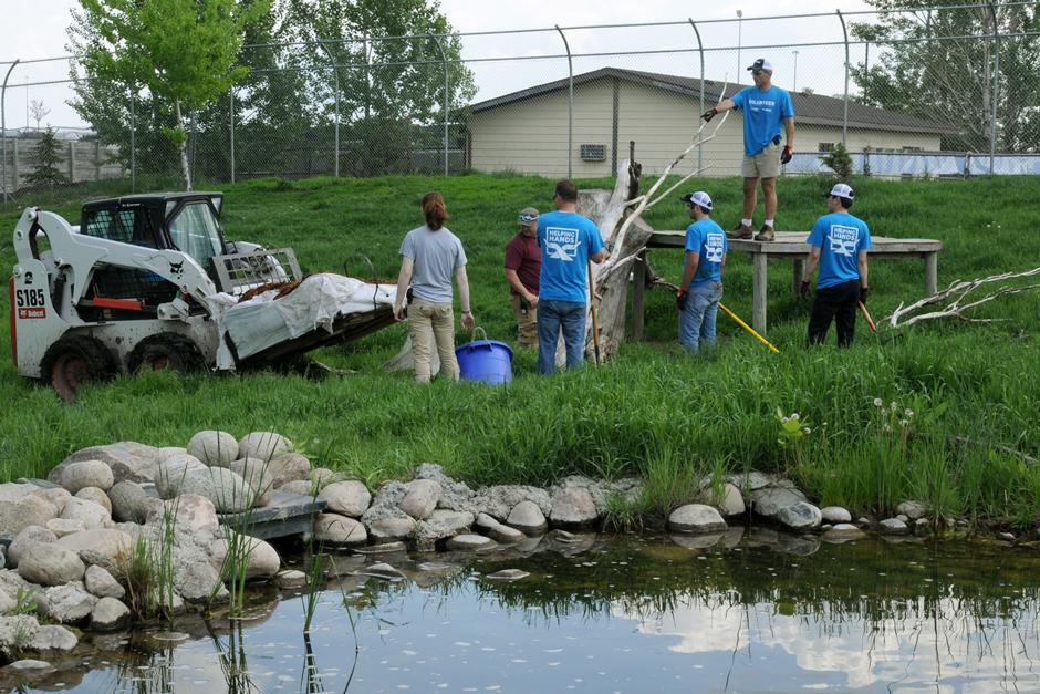 Doosan employees work at the Red River Zoo during the 2014 Doosan Day of Caring in Fargo.