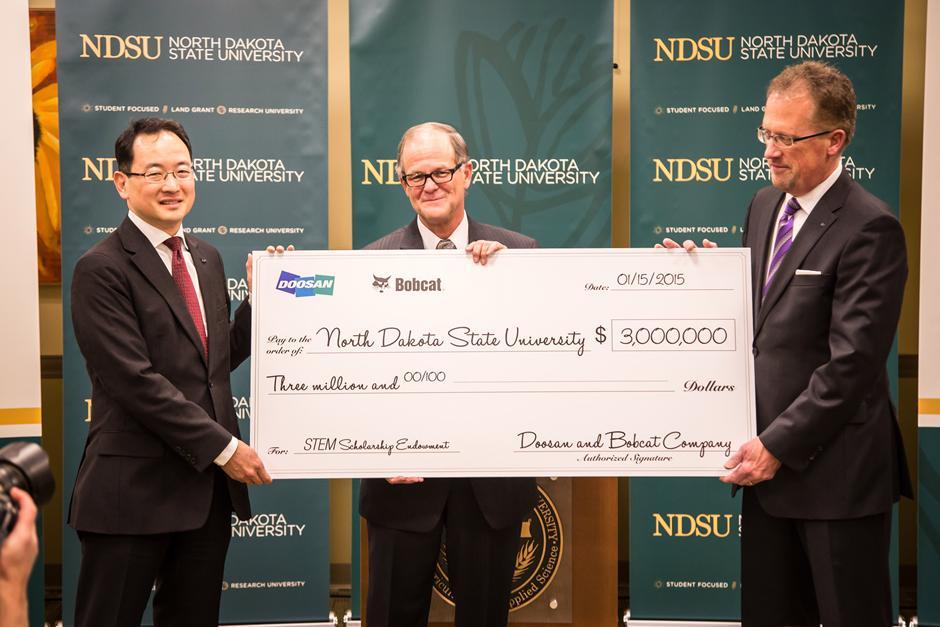 Scott Park, CEO of Doosan Infracore; Dean Bresciani, president of NDSU; Rich Goldsbury, president of Bobcat Company.