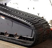 Multi-bar lug pattern tracks on a Bobcat loader.
