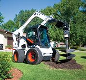 Bobcat all-wheel steer loader with auger attachment.