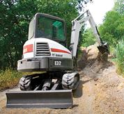 Bobcat compact excavator (mini excavator) with conventional tail swing.
