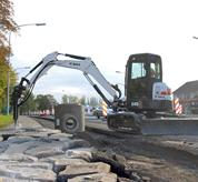 Bobcat compact excavator (mini excavator) with protected hydraulic lines.