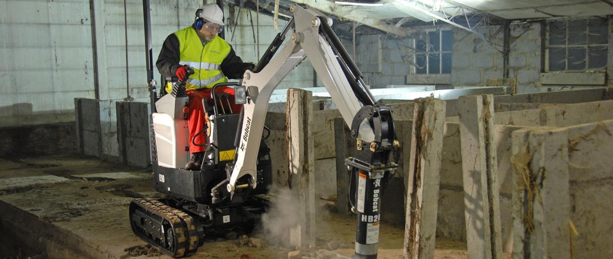 Bobcat compact (mini) Excavator E10 with Breaker attachment in demoliton