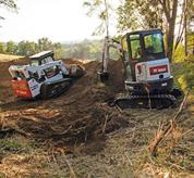Bobcat skid-steer loader and compact excavator combination.