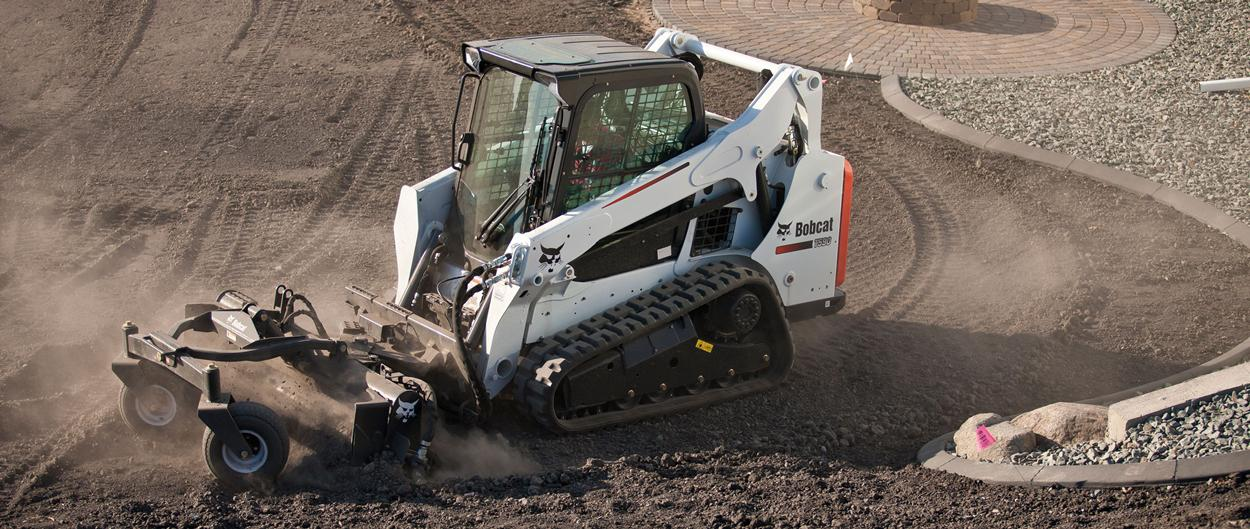 Bobcat T590 compact track loader with land plane attachment.