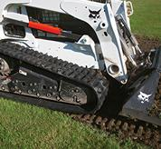 H-Pattern rubber tracks on Bobcat compact track loaders.