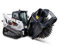 Bobcat T870 compact track loader places earth using the sod layer attachment.