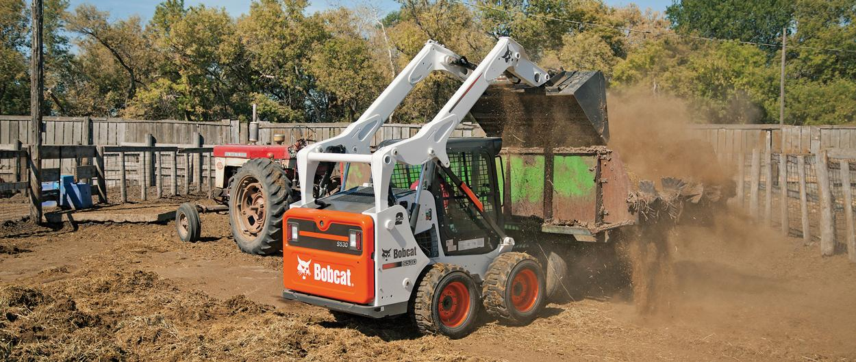 Bobcat S530 skid-steer loader with Bucket attachment.