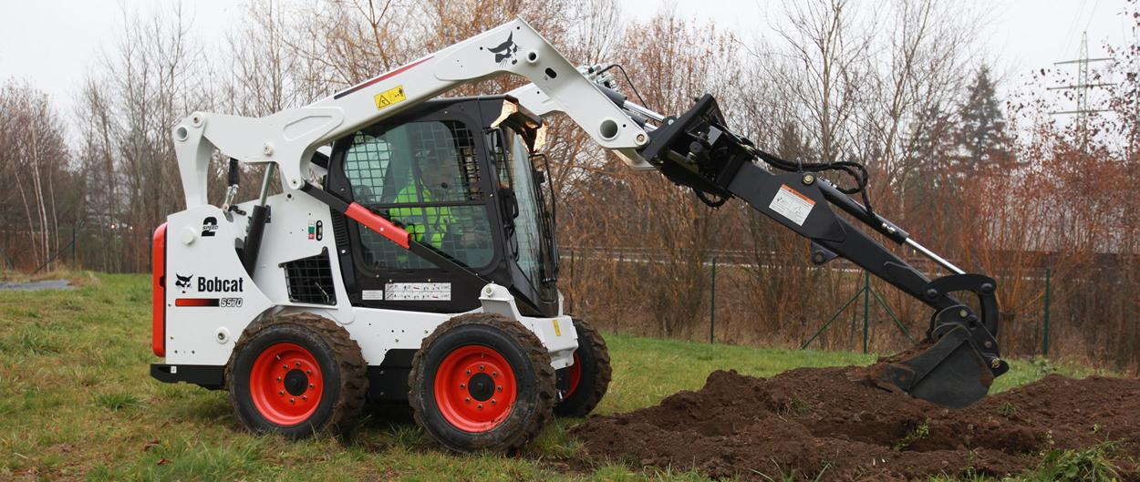 Bobcat S570 skid-steer loader with breaker attachment.