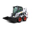 Bobcat S570 skid-steer loader with grapple attachment.