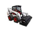 Bobcat S650 skid-steer loader with sweeper attachment.