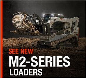 Bobcat M2-Series T770 compact track loader uses a grapple attachment and lighting kit.