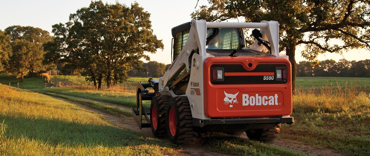 Bobcat S590 Skid-Steer Loader with grapple attachment
