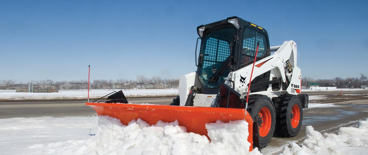 Bobcat S650 skid-steer loader and snow blade attachment.