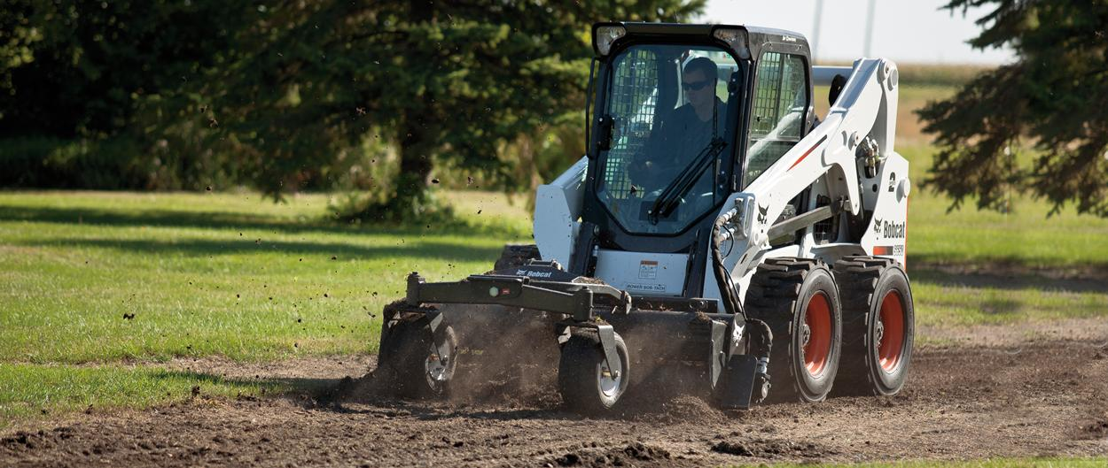 Bobcat skid-steer loaders with soil conditioner attachment.