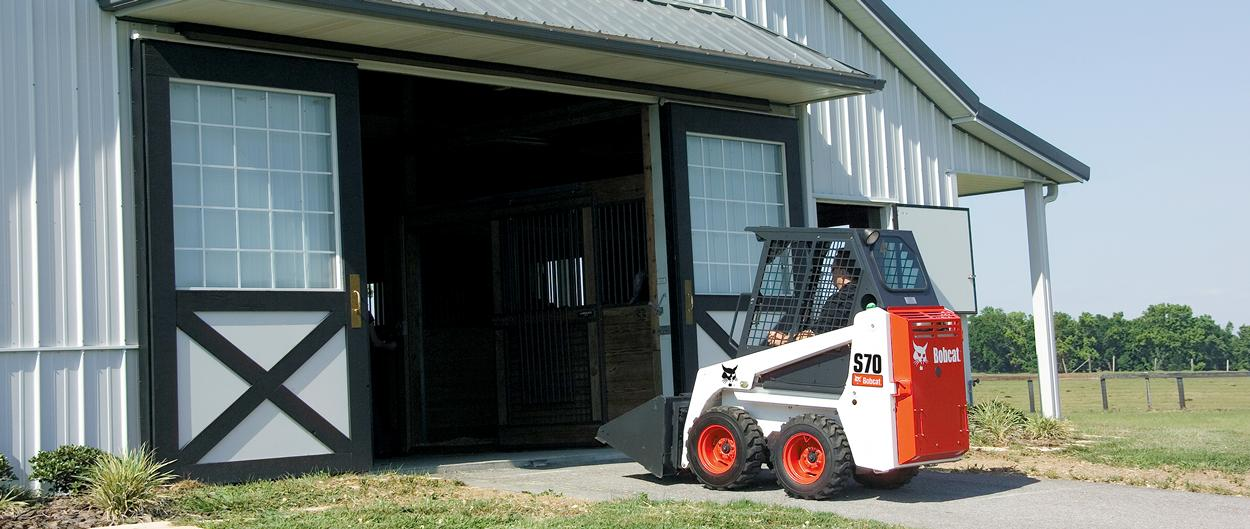 Bobcat S70 skid-steer loader travels into barn