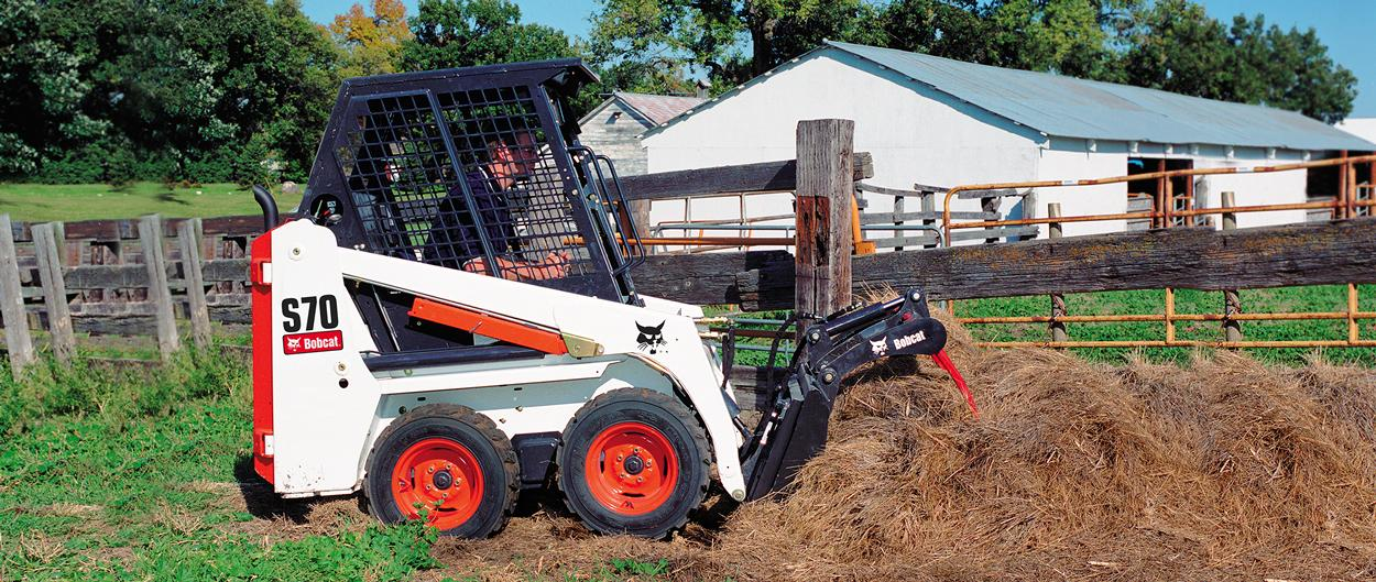 Bobcat S70 skid-steer loader with utility grapple attachment.